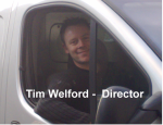 tim in van with title
