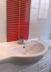 250 x 250 basin with red and white tiles and chrome trim